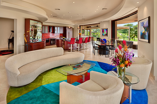 ADC, Inc.'s residence in Wailea makes a modern architectural statement from the home's curved lines and architectural details to the seamless indoor-outdoor transition emphasized through floor-to-ceiling windows and open spaces.
